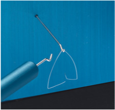 Aluminum handling tool with hook used for transfer of microgram weights.